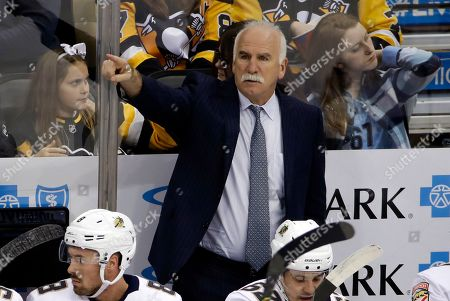 Florida Panthers head coach Joel Quenneville gives instructions during the first period of an NHL hockey game against the Pittsburgh Penguins in Pittsburgh