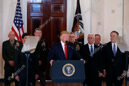United States President Donald Trump, alongside United States Vice President Mike Pence, United States Secretary of State Mike Pompeo, United States Secretary of Defense Dr. Mark Esper, and United States Army General Mark A. Milley, Chairman of the Joint Chiefs of Staff, delivers remarks regarding the Iranian attack on two U.S. military bases in Iraq in the Grand Foyer of the White House.