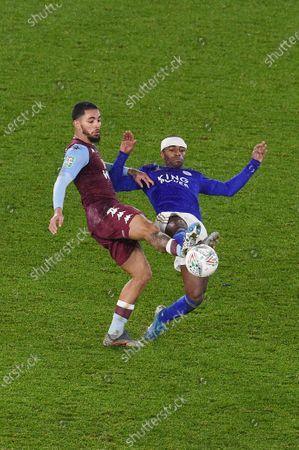 Douglas Luiz of Aston Villa is challenged by Ricardo Pereira of Leicester City.