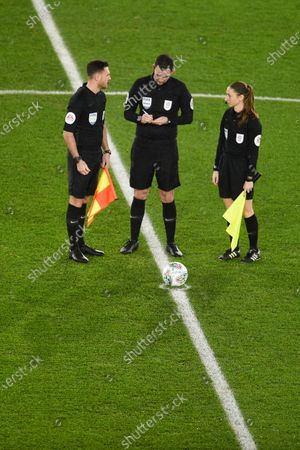 Referee Chris Kavanagh talks to his assistant referees Dan Cook and Sian Massey-Ellis prior to kick off.