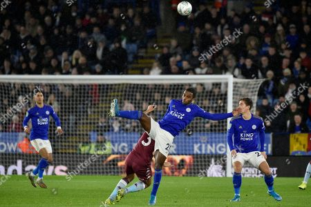 Leicester's Ricardo Pereira, center right is challenged by Aston Villa's Neil Taylor during the English League Cup semifinal first leg soccer match between Leicester City and Aston Villa at the King Power Stadium in Leicester, England