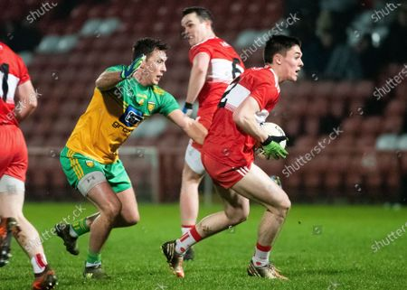 Stock Picture of Derry vs Donegal. Derry's Conor McCluskey and Donegal's Paul Brennan
