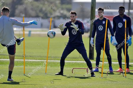 Goalkeepers Matt Turner, center, JT Marcinkowski, second from right, and Sean Johnson, right, of the U.S. Men's National Soccer team, train, in Bradenton, Fla. The team moved its training camp from Qatar to Florida in the wake of Iran's top military commander being killed during a U.S. airstrike in the Middle East