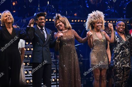 "Phyllida Lloyd, Daniel J. Watts, Tina Turner, Adrienne Warren, Katori Hall. Singer Tina Turner, center, takes a bow during the curtain call with director Phyllida Lloyd, left, Daniel J. Watts, Adrienne Warren and playwright Katori Hall on the opening night of ""Tina ñ The Tina Turner Musical"" at the Lunt-Fontanne Theatre, in New York"