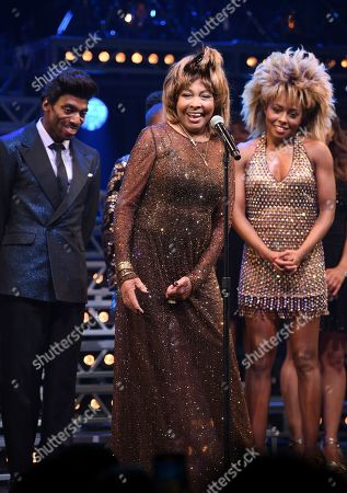 "Stock Photo of Daniel J. Watts, Tina Turner, Adrienne Warren. Singer Tina Turner, center, takes a bow during the curtain call with actors Daniel J. Watts, left, and Adrienne Warren on the opening night of ""Tina ñ The Tina Turner Musical"" at the Lunt-Fontanne Theatre, in New York"