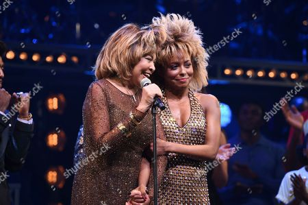 """Tina Turner, Adrienne Warren. Singer Tina Turner, left, speaks on stage with actress Adrienne Warren on the opening night of """"Tina ñ The Tina Turner Musical"""" at the Lunt-Fontanne Theatre, in New York"""
