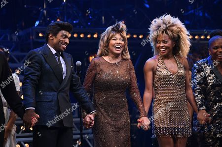 "Daniel J. Watts, Tina Turner, Adrienne Warren. Singer Tina Turner, center, takes a bow during the curtain call with actors Daniel J. Watts, left, and Adrienne Warren on the opening night of ""Tina ñ The Tina Turner Musical"" at the Lunt-Fontanne Theatre, in New York"