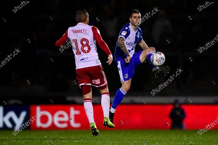 Michael Kelly of Bristol Rovers is marked by Dean Parrett of Stevenage