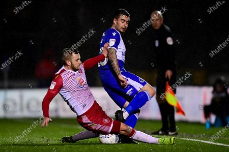 Michael Kelly of Bristol Rovers is tackled by Dean Parrett of Stevenage