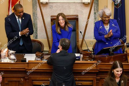 Ralph Northam, Eileen Filler-Corn, Justin Fairfax, Louise Lucas. Virginia Gov. Ralph Northam, bottom, shakes the hand of House Speaker Eileen Filler-Corn, D-Fairfax, as Lt. Gov. Justin Fairfax and Senate President Pro Tem Louise Lucas, D-Portsmouth applaud before a joint session of the Assembly at the state Capitol in Richmond, Va