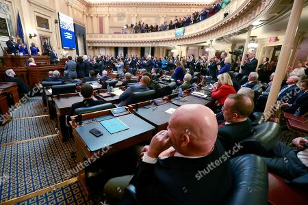 House Republicans sit in their seats as Democratic lawmakers applaud Virginia Gov. Ralph Northam as he delivers his State of the Commonwealth address before a joint session of the Assembly at the state Capitol in Richmond, Va., . Northam was talking about his gun-control legislation