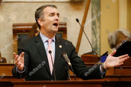 Virginia Gov. Ralph Northam gestures as he delivers his State of the Commonwealth address before a joint session of the Virginia Assembly at the Virginia state Capitol in Richmond, Va