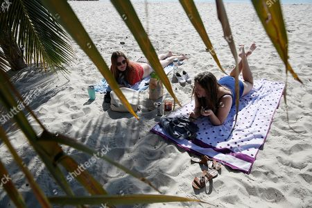 Stock Picture of Shannon Smith, Melissa Smith. The Smith twins, Shannon, left, and Melissa, right, both 25, of Pinecrest, Fla., spend their last day at the beach together before returning to college, in Key Biscayne, Fla