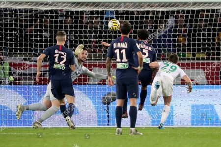 Stock Picture of Saint Etienne's Yohan Cabaye, right, scores his side first goal as PSG's goal keeper Sergio Rico Gonzalez, second left, looks, during the French League Cup quarter final soccer match between Paris Saint Germain and Saint Etienne at the Parc des Princes stadium in Paris