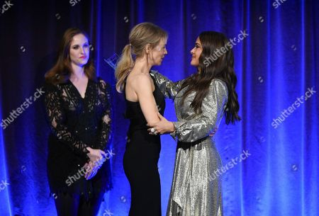 "Renee Zellweger, Salma Hayek Pinault. Actress Renee Zellweger accepts the best actress award for ""Judy"" from Salma Hayek Pinault at the National Board of Review Awards gala at Cipriani 42nd Street, in New York"