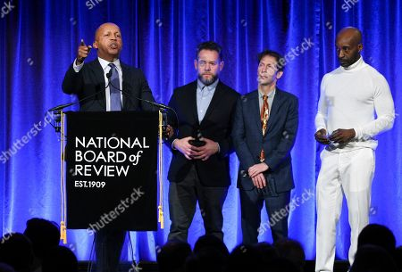 "Bryan Stevenson, Asher Goldstein, Tim Blake Nelson, Rob Morgan. Lawyer Bryan Stevenson, left, and producer Asher Goldstein, actors Tim Blake Nelson and Rob Morgan accept the award NBR freedom of expression award for ""Just Mercy"" at the National Board of Review Awards gala at Cipriani 42nd Street, in New York"