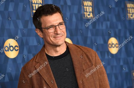 """Nathan Fillion, a cast member in the ABC television series """"The Rookie,"""" poses at the 2020 ABC Television Critics Association Winter Press Tour, in Pasadena, Calif"""