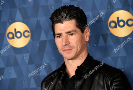 """Michael Fishman, a cast member in the ABC television series """"The Conners,"""" poses at the 2020 ABC Television Critics Association Winter Press Tour, in Pasadena, Calif"""