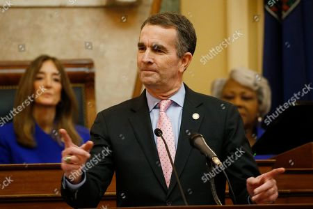 Virginia Gov. Ralph Northam, center, gestures as he delivers his State of the Commonwealth address as House speaker, Eileen Filler-Corn, D-Farifax, left, and Senate President Pro Tempore, Louise Lucas, D-Portsmouth, right listen before a joint session of the Virginia Assembly at the Virginia state Capitol in Richmond, Va