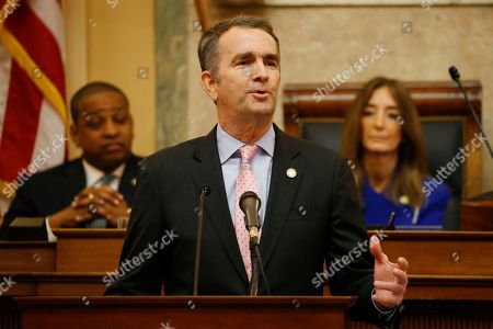 Virginia Gov. Ralph Northam, center, gestures as he delivers his State of the Commonwealth address as House speaker, Eileen Filler-Corn, D-Farifax, right, and Lt. Gov. Justin Fairfax, left, listen before a joint session of the Virginia Assembly at the Virginia state Capitol in Richmond, Va