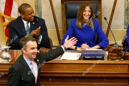 Virginia Gov. Ralph Northam, bottom left, recognizes House speaker, Eileen Filler-Corn, D-Farifax, right, as he prepares to deliver his State of the Commonwealth address as Lt. gov. Justin Fairfax, top left, applauds before a joint session of the Virginia Assembly at the Virginia state Capitol in Richmond, Va