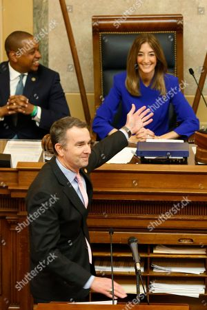 Stock Image of Virginia Gov. Ralph Northam, bottom left, recognizes House speaker, Eileen Filler-Corn, D-Farifax, right, as he prepares to deliver his State of the Commonwealth address as Lt. Gov. Justin Fairfax, top left, applauds before a joint session of the Virginia Assembly at the Virginia state Capitol in Richmond, Va