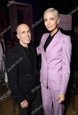 Jeffrey Katzenberg and Charlize Theron