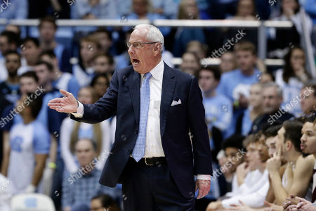 North Carolina head coach Roy Williams dirtects his players during the second half of an NCAA college basketball game against Pittsburgh in Chapel Hill, N.C