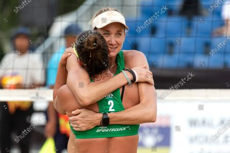 Kerri Walsh Jennings (R) and Brooke Sweat (L) of USA embraces after winning the Semifinals against Germany on Day 3