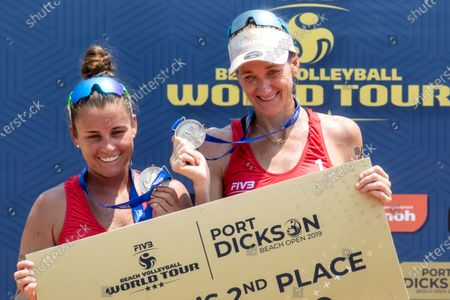 Brooke Sweat (L) and Kerri Walsh Jennings (R) of USA receive silver medals