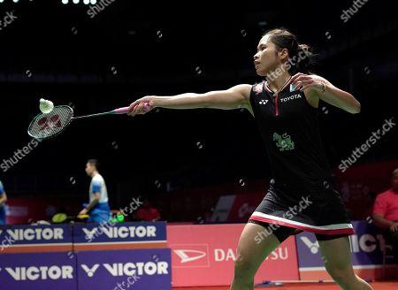 Thailand's Ratchanok Intanon returns a shot against China's Wang Zhi Yi during the round 16 of Malaysia Master 2020 badminton tournament in Kuala Lumpur, Malaysia