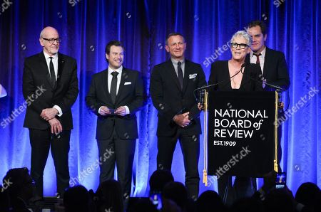 """Frank Oz, Noah Segan, Daniel Craig, Jamie Lee Curtis, Michael Shannon. Actress Jamie Lee Curtis speaks on behalf of """"Knives Out"""" cast members Frank Oz, left, Noah Segan, Daniel Craig and Michael Shannon while accepting the best ensemble award at the National Board of Review Awards gala at Cipriani 42nd Street, in New York"""