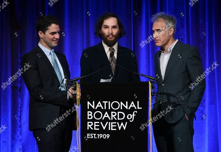 """Benny Safdie, Josh Safdie, Ronald Bronstein. Filmakers Benny Safdie, left, Josh Safdie, Ronald Bronstein accept the best original screenplay award for """"Uncut Gems,"""" at the National Board of Review Awards gala at Cipriani 42nd Street, in New York"""
