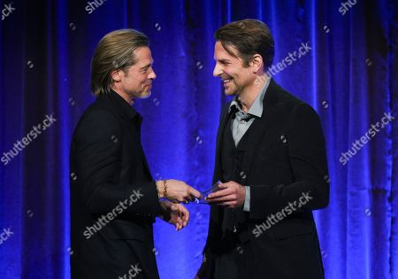 """Brad Pitt, Bradley Cooper. Actor Brad Pitt, left, accepts the best supporting actor award for """"Once Upon A Time in Hollywood,"""" from actor Bradley Cooper at the National Board of Review Awards gala at Cipriani 42nd Street, in New York"""