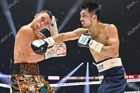 Ryota Murata of Japan (R) and Steven Butler of Canada fight in the 2nd round of their WBA Middleweight title bout