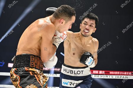 Ryota Murata of Japan (R) and Steven Butler of Canada fight in the 1st round of their WBA Middleweight title bout