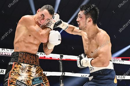 Ryota Murata of Japan (R) and Steven Butler of Canada fight in the 4th round of their WBA Middleweight title bout