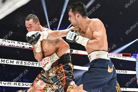 Stock Photo of Ryota Murata of Japan (R) and Steven Butler of Canada fight in the 5th round of their WBA Middleweight title bout