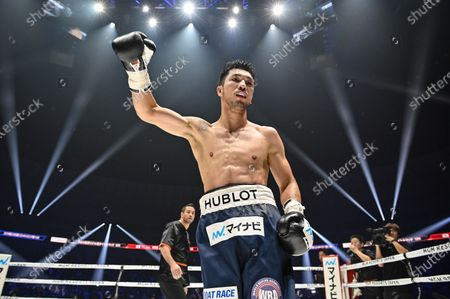 Ryota Murata of Japan celebrates after knocking out Steven Butler of Canada in the 5th round of their WBA Middleweight title bout