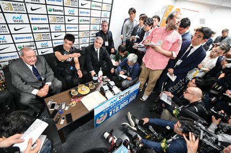 Ryota Murata of Japan (C) talks with media after knocking out Steven Butler of Canada at the WBA Middleweight title bout They after from left ; promoter Bob Arum, Ryota Murata and representative of the Teiken Promotions Tsuyoshi Hamada.
