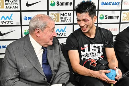 Ryota Murata of Japan (R) and promoter Bob Arum talk with media after knocking out Steven Butler of Canada at the WBA Middleweight title bout