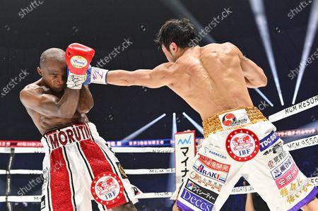 Japan's Akira Yaegashi (R) and South Africa's Moruti Mthalane fight at the 4th round during the IBF flyweight title boxing bout at Yokohama Arena