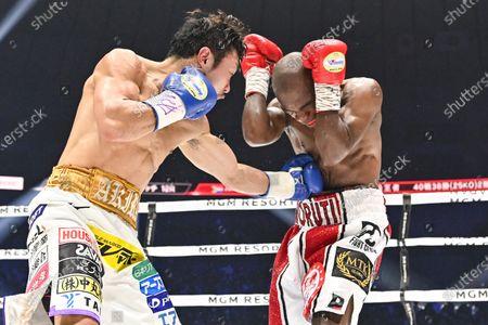 Japan's Akira Yaegashi (L) and South Africa's Moruti Mthalane fight at the 4th round during the IBF flyweight title boxing bout at Yokohama Arena