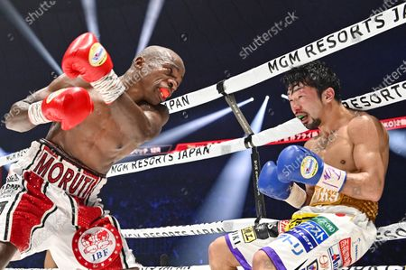 Stock Picture of Japan's Akira Yaegashi (R) and South Africa's Moruti Mthalane fight at the 8th round during the IBF flyweight title boxing bout at Yokohama Arena