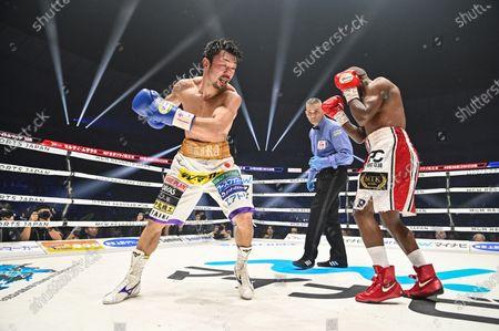 Stock Photo of Japan's Akira Yaegashi (L) and South Africa's Moruti Mthalane fight at the 8th round during the IBF flyweight title boxing bout at Yokohama Arena