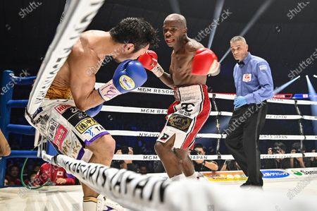 Japan's Akira Yaegashi (L) and South Africa's Moruti Mthalane fight at the 9th round during the IBF flyweight title boxing bout at Yokohama Arena