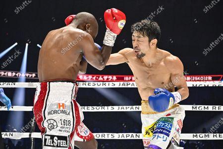 Japan's Akira Yaegashi (R) and South Africa's Moruti Mthalane fight at the 1st round during the IBF flyweight title boxing bout at Yokohama Arena