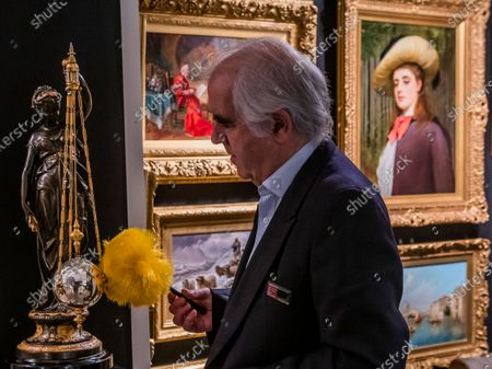 Richard Price and a rare French mystery clock of Ceres, goddess of the harvest and fertility, c.1885 (£18,750), by A. R. Guilmet - The Mayfair Antiques & Fine Art Fair, London Marriott Hotel. It runs from Thursday 9 until Sunday 12 January 2020.