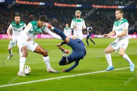 PSG's Brazilian forward Neymar Jr. is tackled by Saint-Etienne's Wesley Fofana in pesence of Yohan Cabaye (R)