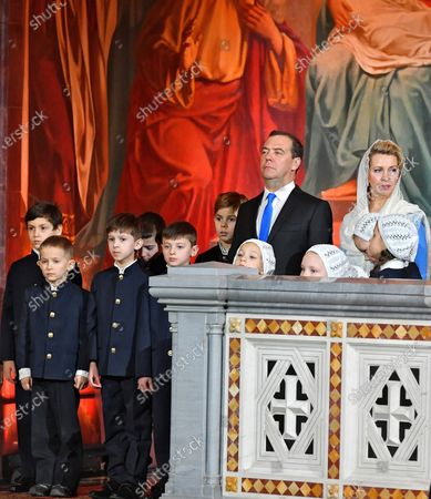Christmas mass in the Cathedral of Christ the Savior. Russian Prime Minister Dmitry Medvedev (center) and his wife Svetlana Medvedeva (right) attend the mass